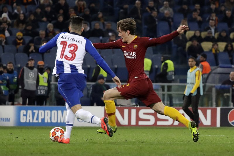 Roma midfielder Nicolo' Zaniolo, right, scores the opening goal of his team during a Champions League round of 16 first leg soccer match between Roma and Porto, at Rome's Olympic Stadium, Tuesday, Feb. (AP Photo/Andrew Medichini)