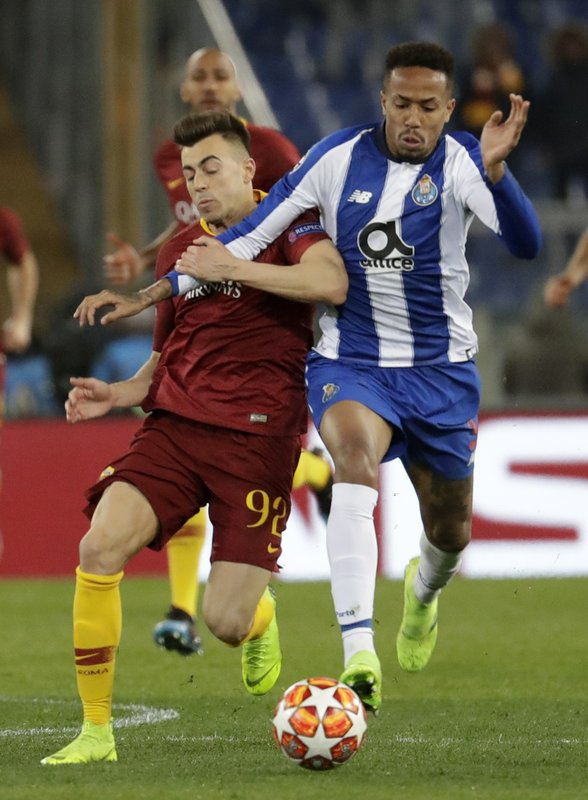 Porto defender Eder Militao, right, and Roma forward Stephan El Shaarawy fight for the ball during a Champions League round of 16 first leg soccer match between Roma and Porto, at Rome's Olympic Stadium, Tuesday, Feb. (AP Photo/Andrew Medichini)