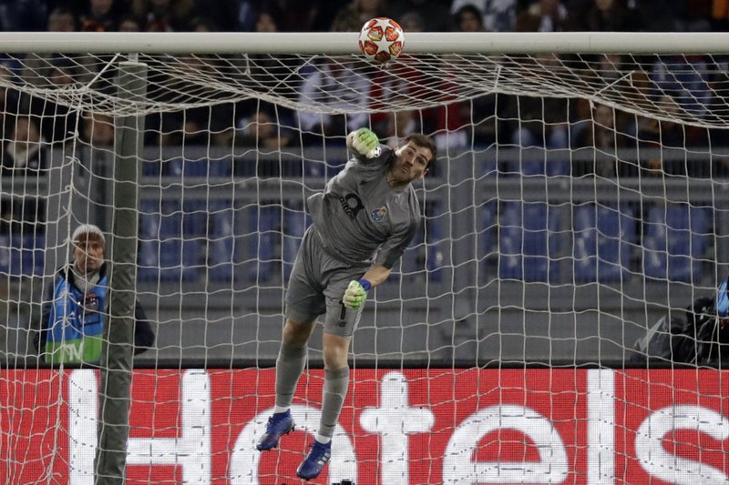 Porto goalkeeper Iker Casillas saves a ball during a Champions League round of 16 first leg soccer match between Roma and Porto, at Rome's Olympic Stadium, Tuesday, Feb. (AP Photo/Andrew Medichini)
