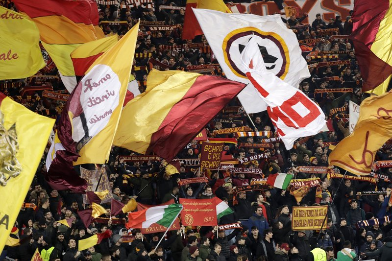 Roma fans cheer for their team before a Champions League round of 16 first leg soccer match between Roma and Porto, at Rome's Olympic Stadium, Tuesday, Feb. (AP Photo/Andrew Medichini)