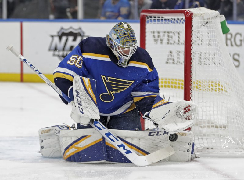 St. Louis Blues goaltender Jordan Binnington (50) makes a save in the first period of an NHL hockey game against the New Jersey Devils, Tuesday, Feb. (AP Photo/Tom Gannam)