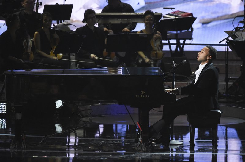 John Legend performs during Motown 60: A GRAMMY Celebration at the Microsoft Theater on Tuesday, Feb. (Photo by Richard Shotwell/Invision/AP)