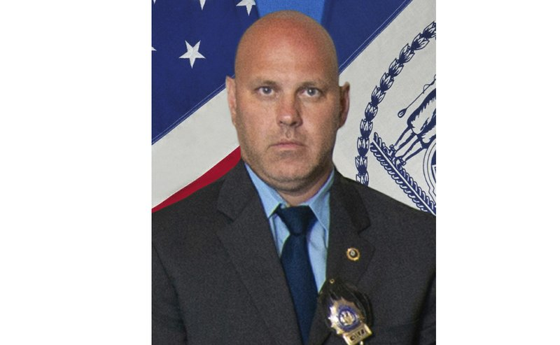 In this undated photo provided by the New York City Police Department, Det. Brian Simonsen is shown. New York Police Commissioner James O'Neill told the media during a news conference that Simonsen was shot and killed by friendly fire Tuesday night, Feb. (New York City Police Department via AP)