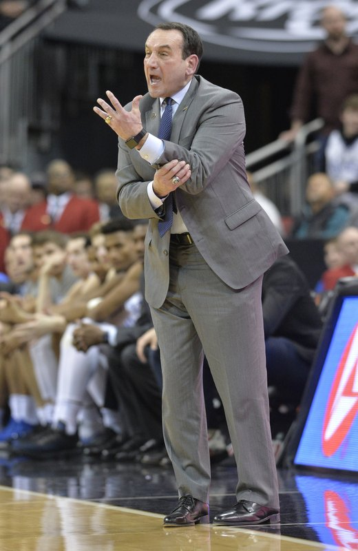 Duke head coach Mike Krzyzewski argues a call during the second half of the team's NCAA college basketball game against Louisville in Louisville, Ky. (AP Photo/Timothy D. Easley)