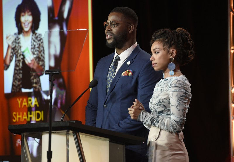 Logan Browning, right, reacts as Winston Duke announces her as a nominee for the 50th annual NAACP Image Awards during TV One's Winter Television Critics Association Press Tour on Wednesday, Feb. (Photo by Chris Pizzello/Invision/AP)