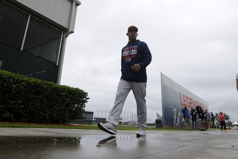 Boston Red Sox manager Alex Cora walks to the batting cages as pitchers and catchers report for their first workout at their spring training baseball facility in Ft. (AP Photo/Gerald Herbert) Alex Cora