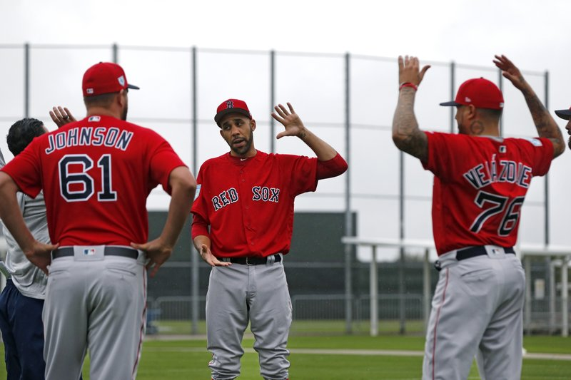 Boston Red Sox starting pitcher David Price, center, warms up with starting pitcher Brian Johnson (61) and starting pitcher Hector Velazquez (76), as pitchers and catchers report for their first workout at their spring training baseball facility in Ft. (AP Photo/Gerald Herbert)