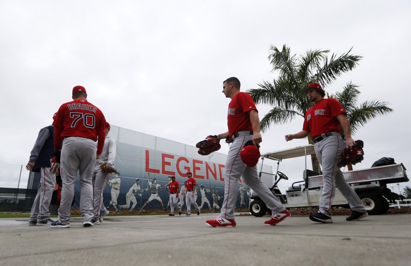 Boston Red Sox pitchers and catchers report for their first workout at their spring training baseball facility in Ft. (AP Photo/Gerald Herbert)