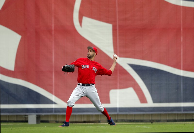 Boston Red Sox starting pitcher David Price warms up as pitchers and catchers reportde for their first workout at their spring training baseball facility in Ft. (AP Photo/Gerald Herbert)