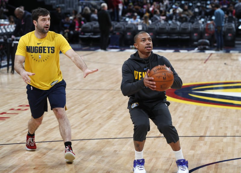 FILE - In this Monday, Feb. 11, 2019, file photo, Denver Nuggets guard Isaiah Thomas takes a practice shot before an NBA basketball game against the Miami Heat in Denver. (AP Photo/David Zalubowski, File)