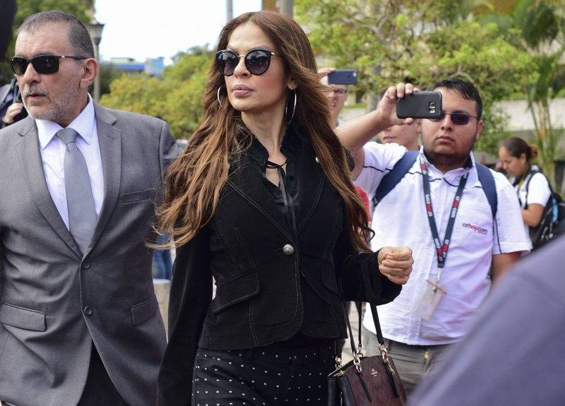 Former Miss Costa Rica 1994, Jazmin Morales, walks after filing a complaint against former President Oscar Arias, in San Jose, Costa Rica, Wednesday, Feb. (AP Photo/Carlos Gonzalez)