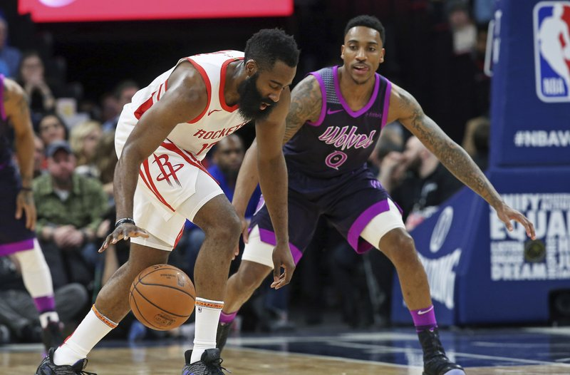 Houston Rockets' James Harden, left, dribbles as Minnesota Timberwolves' Jeff Teague defends in the first half of an NBA basketball game, Wednesday, Feb. (AP Photo/Jim Mone)