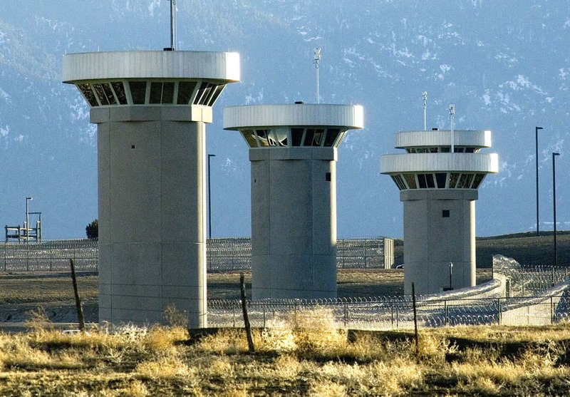 FILE - In this Feb. 21, 2007, file photo, guard towers loom over the administrative maximum security federal prison called Supermax near Florence, Colo. (Chris McLean/The Pueblo Chieftain via AP)