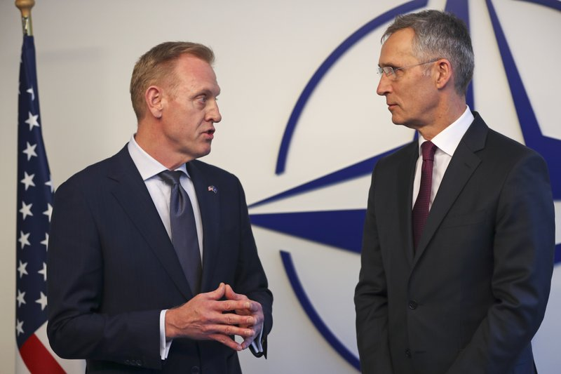 Acting US Defence Secretary Patrick Shanahan, left, talks to NATO's Secretary General Jens Stoltenberg for the media during a meeting of NATO defence ministers at NATO headquarters in Brussels, Wednesday, Feb. (AP Photo/Francisco Seco)