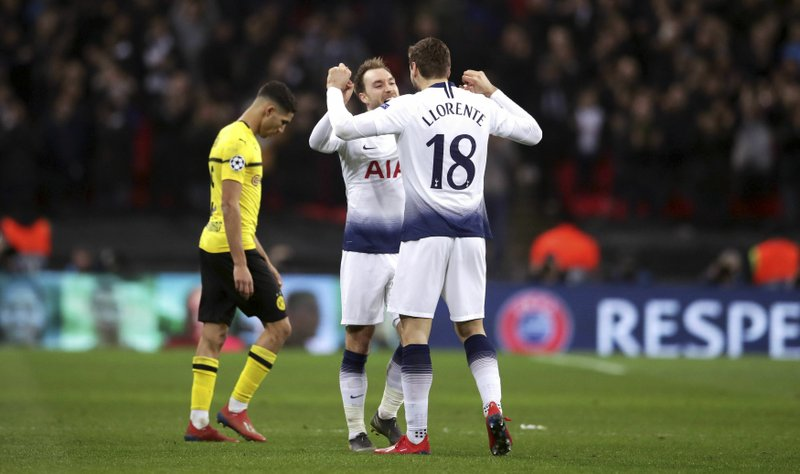 Tottenham Hotspur's Christian Eriksen, left, and Fernando Llorente embrace after the UEFA Champions League round of 16, first leg match at Wembley Stadium, London Wednesday February 13, 2019. (Adam Davy/PA Wire via AP)