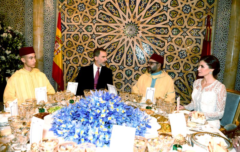 This photo provided by the Moroccan Royal Palace via the Moroccan News Agency (MAP), shows, from left to right : Morocco's Crown Prince Molly Hassan, King Don Felipe VI of Spain, Moroccan King Mohammed VI and Queen Dona Letizia of Spain before a royal diner at the king palace in Rabat, Morocco Wednesday Feb. (Moroccan Royal Palace via AP)