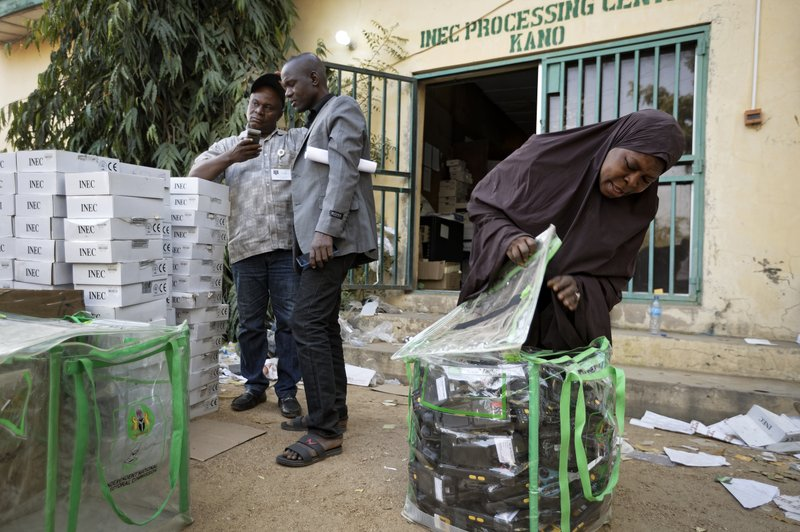 An electoral worker prepares identity card and biometric verification readers, at the offices of the Independent National Electoral Commission in Kano, northern Nigeria Thursday, Feb. (AP Photo/Ben Curtis)