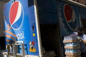 PepsiCo moves to profit in 4Q, sees tax benefit