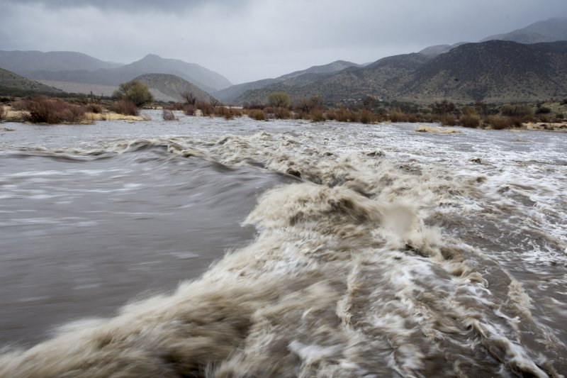 The Mojave River floods near the Deep Creek Spillway and Lake Arrowhead road in Hesperia, Calif. on Thursday Feb. (James Quigg/The Daily Press via AP)