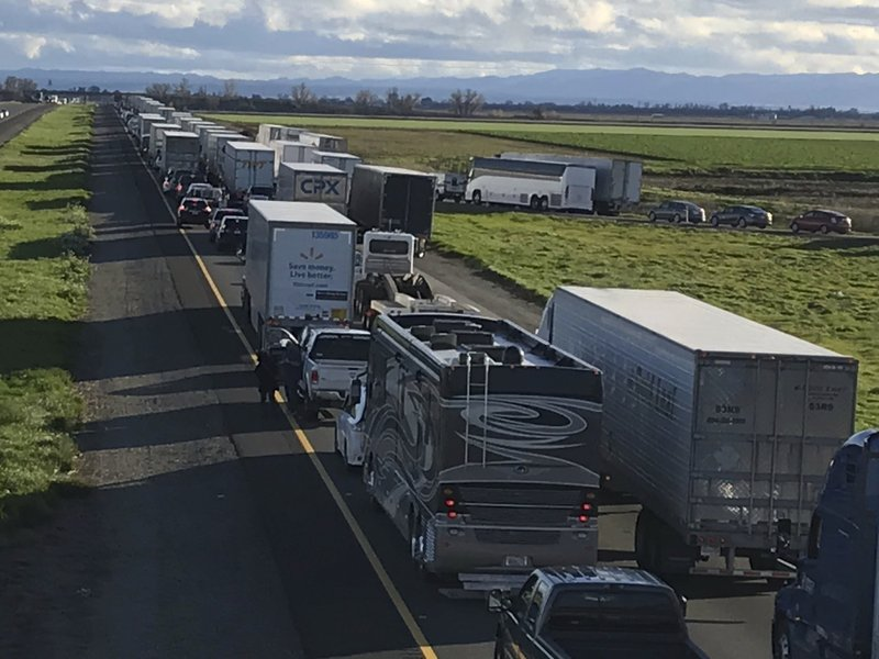 This Feb. 14, 2019, photo released by Caltrans District 3 shows a 7-mile back up on the South bound Interstate 5, as it reopens to traffic in Maxwell in Colusa County, Calif. (Caltrans District 3 via AP)