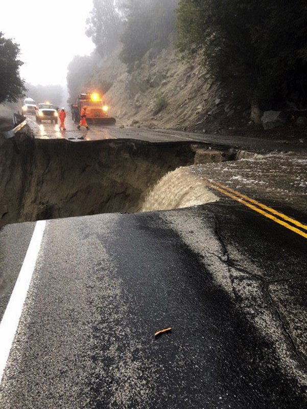 This photo released by Caltrans District 8 shows damage to Highway 243 near Lake Fulmor, Calif., Thursday, Feb. (Caltrans District 8 via AP)