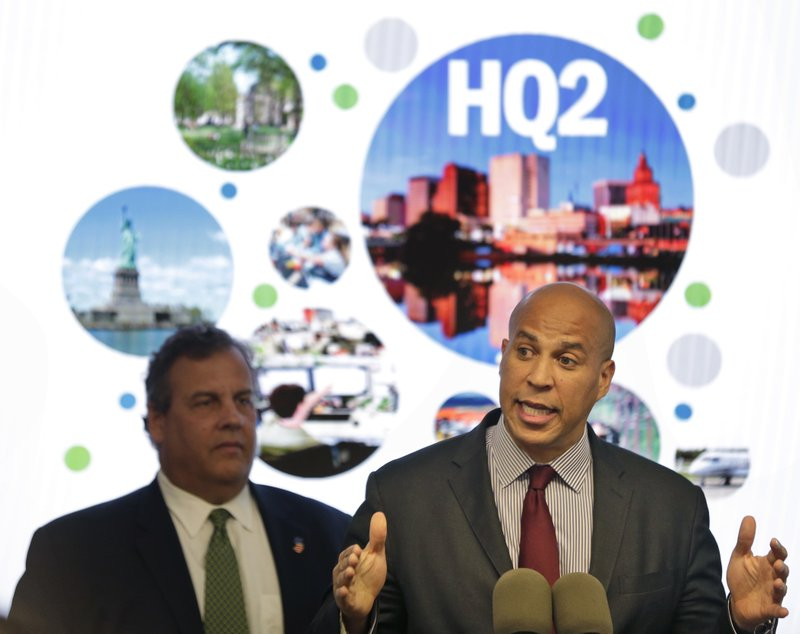 FILE - In this Oct. 16, 2017, file photo, New Jersey Sen. Cory Booker, right, speaks while New Jersey Gov. (AP Photo/Seth Wenig, File)