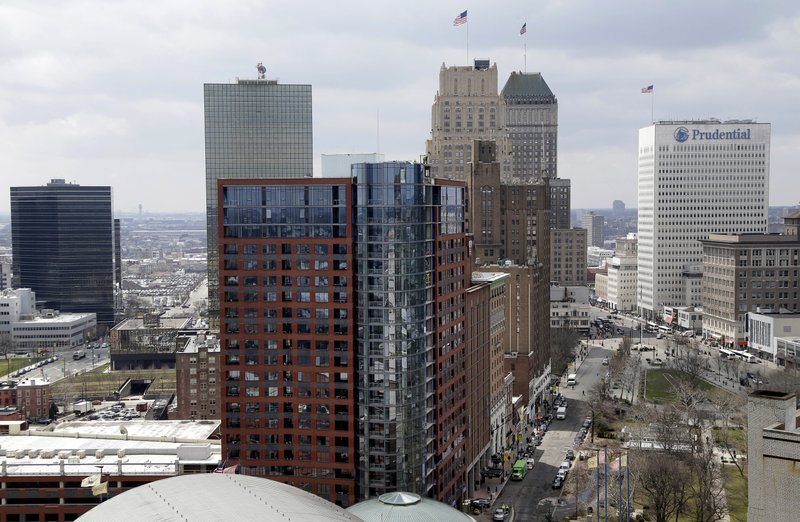 """FILE - This April 10, 2018, file photo shows part of the skyline in Newark, N.J. Officials in Newark, which was one of the 18 finalists that Amazon rejected in November when it announced it would split its HQ2 between New York and northern Virginia, sent a giant heart that said """"NJ & Newark Still Love U, Amazon!"""" The love note came despite Amazon saying it's not seeking a new site. (AP Photo/Seth Wenig, File)"""