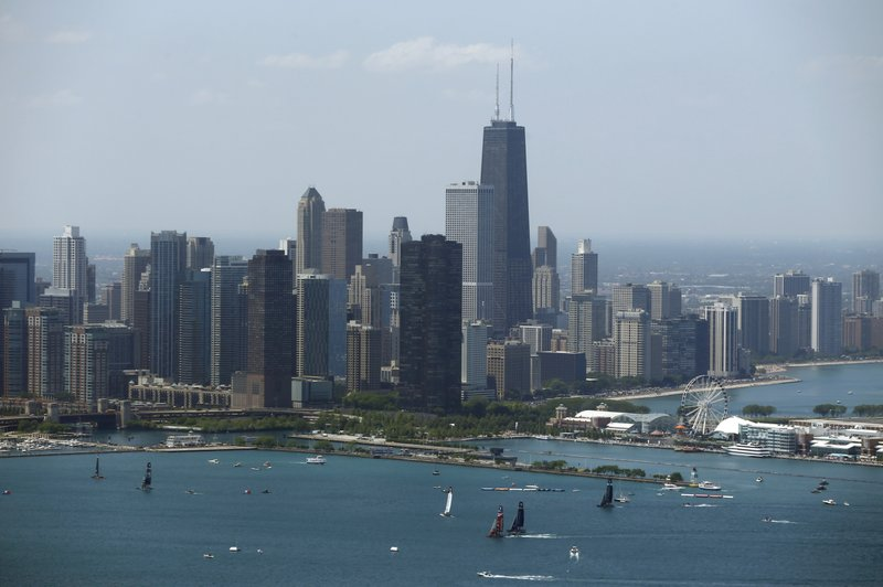 FILE - In this June 10, 2016, file photo, sailboats practice in front of the downtown Chicago skyline during practice for an America's Cup World Series sailing event. (AP Photo/Kiichiro Sato, File)