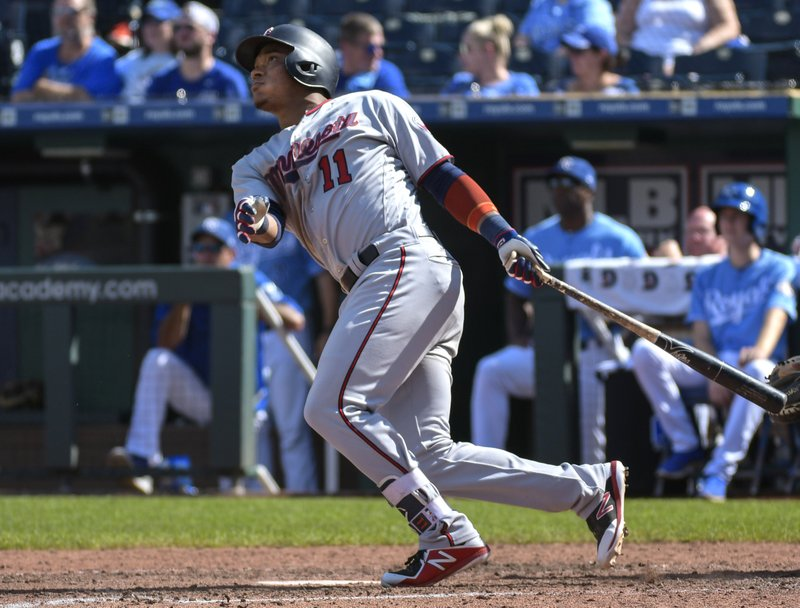 FILE - In this Sept. 16, 2018, file photo, Minnesota Twins' Jorge Polanco hits a home run during the sixth inning of a baseball game against the Kansas City Royals in Kansas City, Mo. (AP Photo/Reed Hoffmann, File)