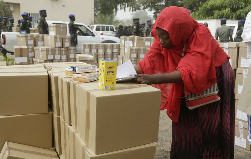 An electoral worker takes stock of ballot papers to be transporters at the offices of the Independent National Electoral Commission in Yola, Nigeria, Friday, Feb. (AP Photo/Sunday Alamba)