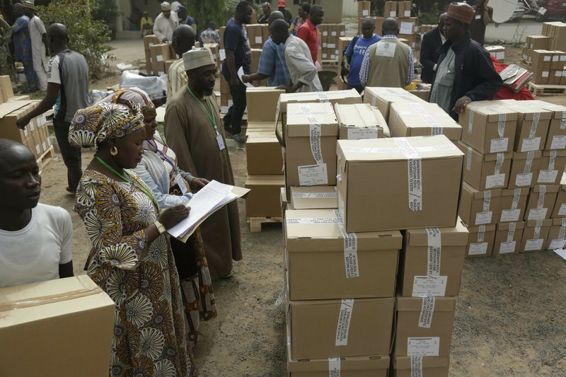 An electoral worker take stock of ballot papers to be transporters at the offices of the Independent National Electoral Commission in Yola, Nigeria, Friday, Feb. (AP Photo/Sunday Alamba)