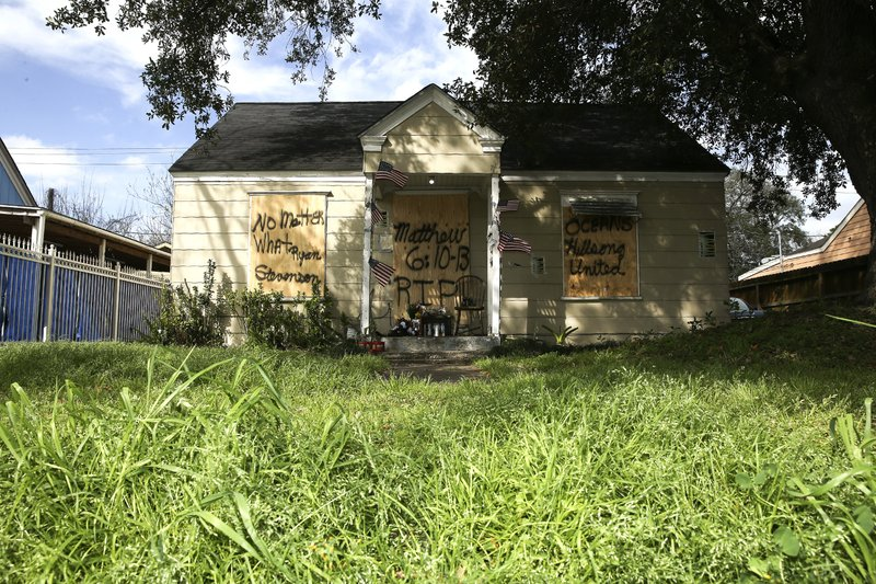 Boards cover the front of a home at 7815 Harding Street in Houston, Friday, Feb. 15, 2019, where the occupants of the home were shot to death during a police raid on Jan. (Elizabeth Conley/Houston Chronicle via AP)