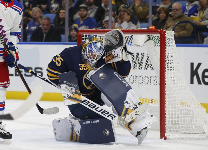 Buffalo Sabres goalie Linus Ullmark (35) makes a save during the second period of an NHL hockey game against the New York Rangers, Friday, Feb. (AP Photo/Jeffrey T. Barnes)