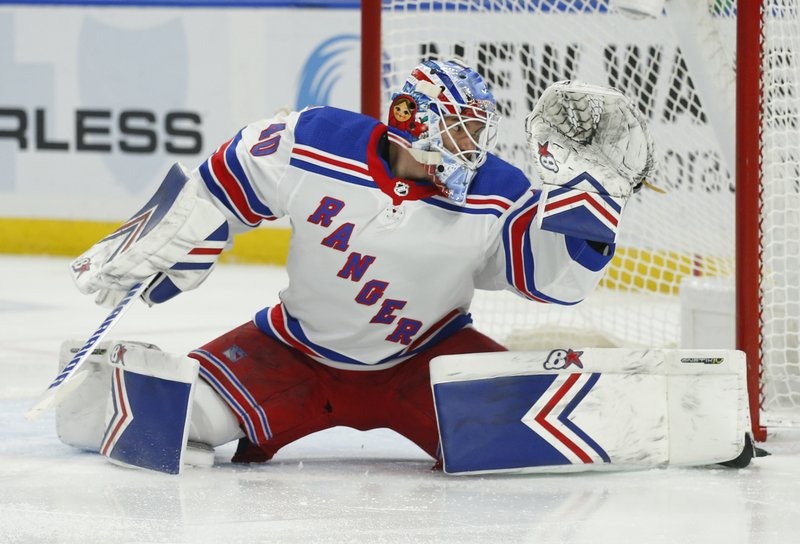 New York Rangers goalie Alexandar Georgiev (40) makes a save during the first period of an NHL hockey game against the Buffalo Sabres, Friday, Feb. (AP Photo/Jeffrey T. Barnes)