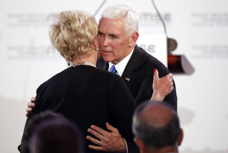 United States Vice President Mike Pence hugs Cindy McCain, widow of US Senator John McCain, after delivering his speech during the John McCain Dissertation Award Ceremony at the Bavarian State Parliament in Munich, Germany, Friday, Feb. (AP Photo/Matthias Schrader)