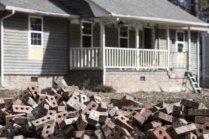 A pile of bricks sits in front of a home scheduled to be raised after being damaged by flooding from Hurricane Florence near the Crabtree Swamp, Friday, Feb. (AP Photo/Sean Rayford)