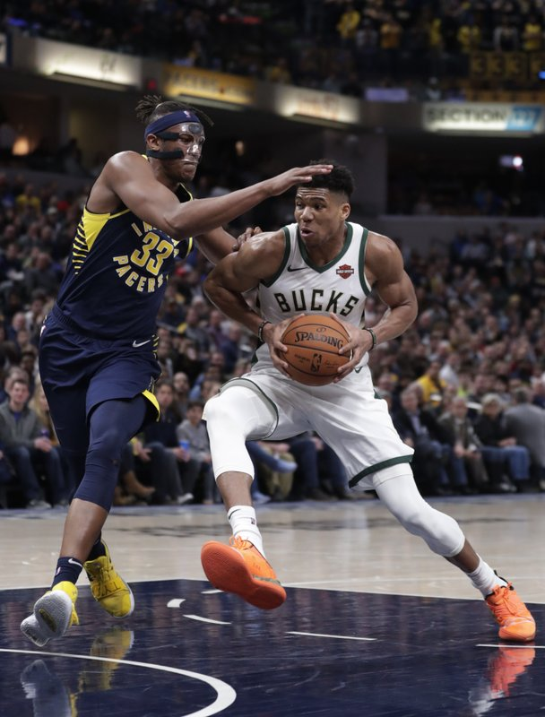 Milwaukee Bucks forward Giannis Antetokounmpo (34) drives on Indiana Pacers center Myles Turner (33) during the second half of an NBA basketball game in Indianapolis, Wednesday, Feb. (AP Photo/Michael Conroy)