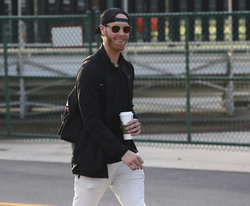 Atlanta Braves pitcher Mike Foltynewicz arrives as pitchers and catchers report for the first day at baseball spring training in Kissimmee, Fla. (Curtis Compton/Atlanta Journal-Constitution via AP)
