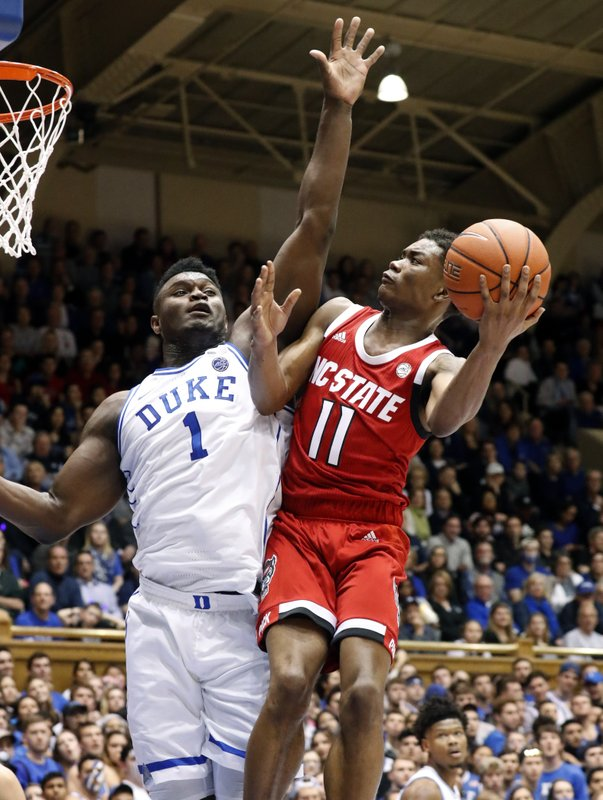 Duke's Zion Williamson (1) defends North Carolina State's Markell Johnson (11) during the first half of an NCAA college basketball game in Durham, N. (AP Photo/Chris Seward)