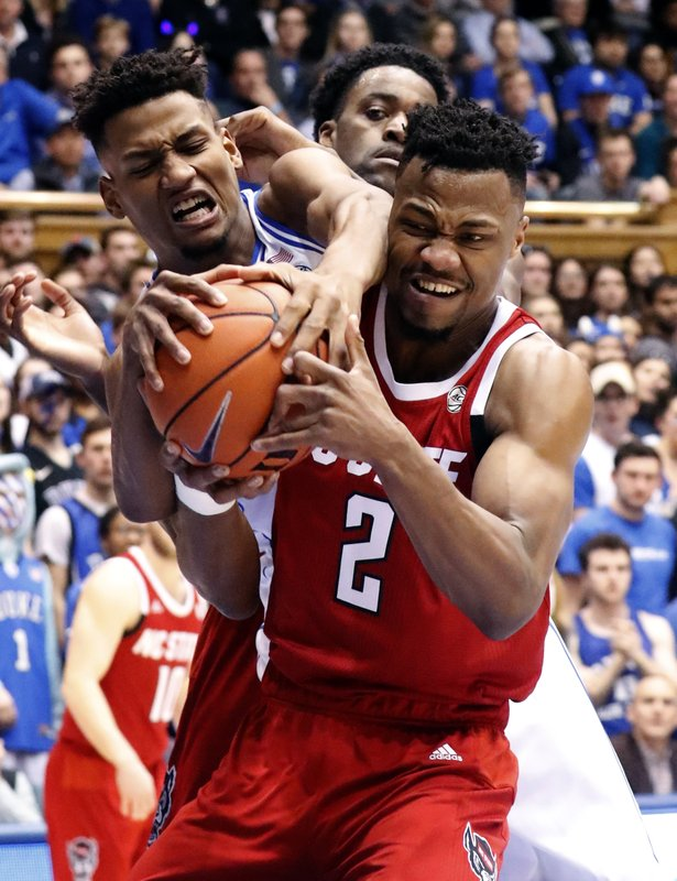 Duke's Javin DeLaurier (12) and North Carolina State's Torin Dorn (2) battle for the ball during the first half of an NCAA college basketball game in Durham, N. (AP Photo/Chris Seward)