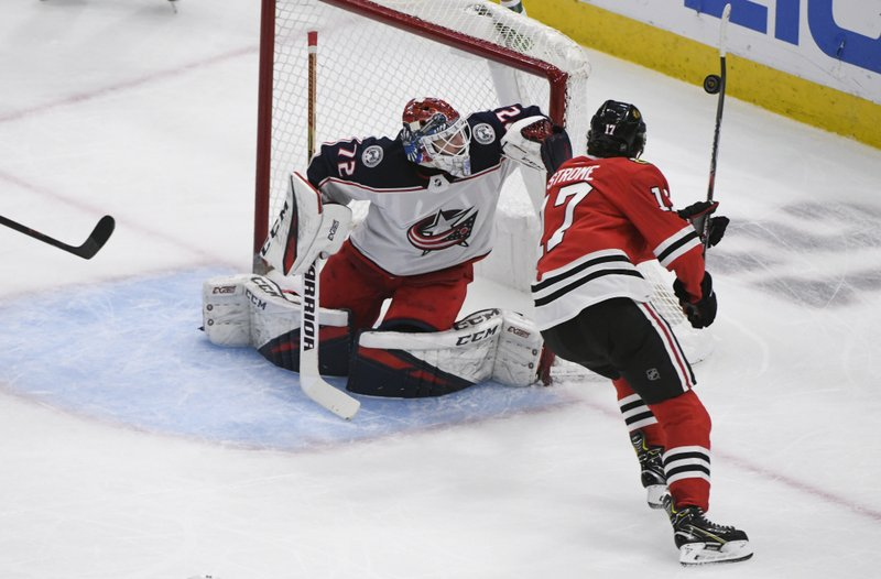Columbus Blue Jackets goaltender Sergei Bobrovsky (72) defends against Chicago Blackhawks center Dylan Strome (17), who tries to knock down the puck during the second period of an NHL hockey game Saturday, Feb. (AP Photo/Matt Marton)
