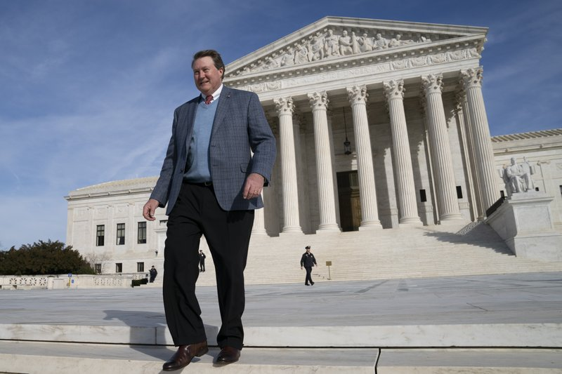 Mitch Hungerpiller of Birmingham, Ala., who invented a computerized system to automate the processing of returned mail, visits the Supreme Court in Washington, on Feb. (AP Photo/J. Scott Applewhite)