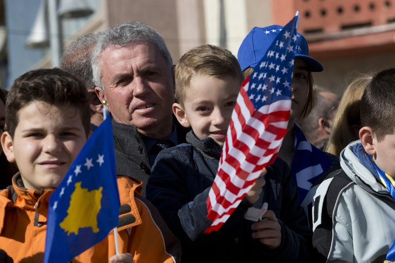 Kosovars waving national and U.S flags gather, during celebrations to mark the 11th anniversary of independence, in Pristina, Sunday, Feb. (AP Photo/Visar Kryeziu)(AP Photo/Visar Kryeziu)