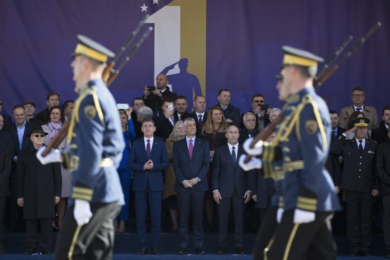 Kosovo president Hashim Thaci, center, watches the Kosovo Security Force members parade, during celebrations to mark the 11th anniversary of independence in Pristina, Sunday, Feb. (AP Photo/Visar Kryeziu)