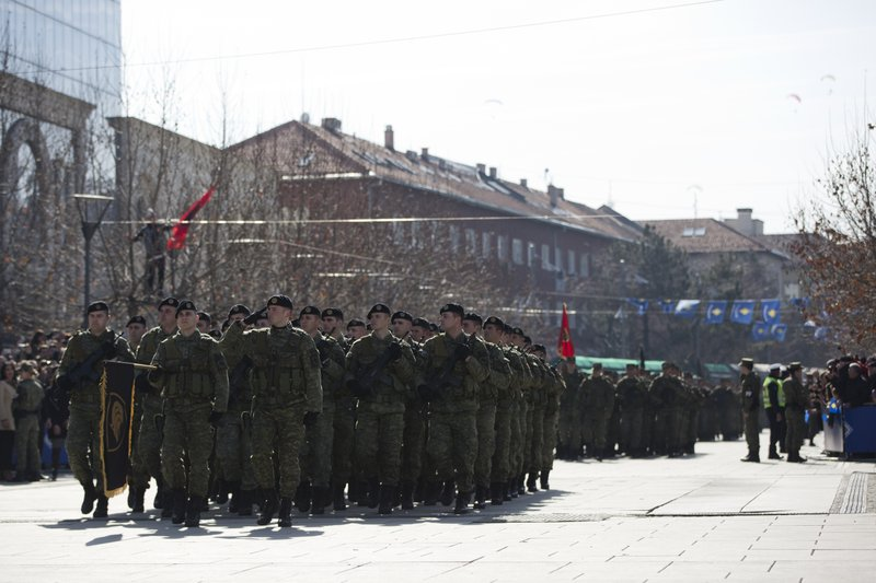 Kosovo Security Force members march during celebrations to mark the 11th anniversary of independence, in Pristina, Sunday, Feb. (AP Photo/Visar Kryeziu)