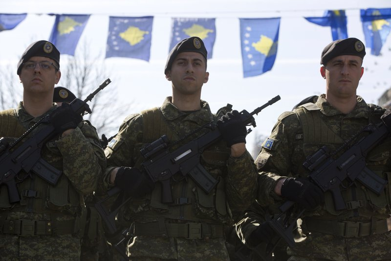 Kosovo Security Force members march during the celebration to mark the 11th anniversary of independence in Pristina, Sunday, Feb. (AP Photo/Visar Kryeziu)