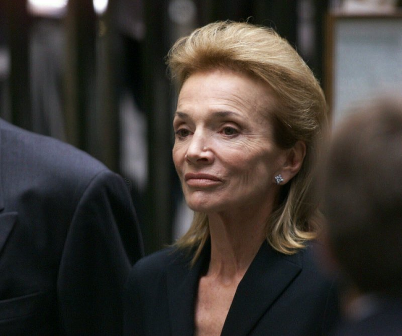 FILE - In this July 23, 1999 file photo, Lee Radziwill, sister of Jacqueline Kennedy Onassis, leaves the Church of St. (AP Photo/Doug Mills, File)