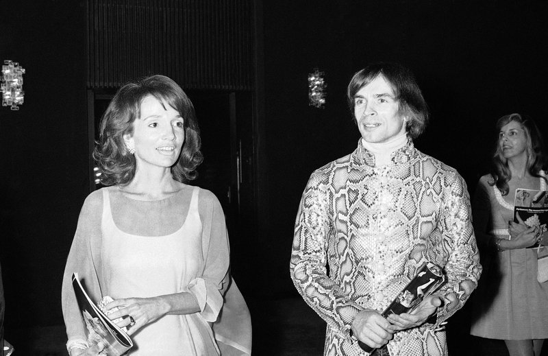 FILE - In this May 8, 1974 file photo, dancer Rudolf Nureyev, right, and Princess Lee Radziwill talk together during intermission at a performance of