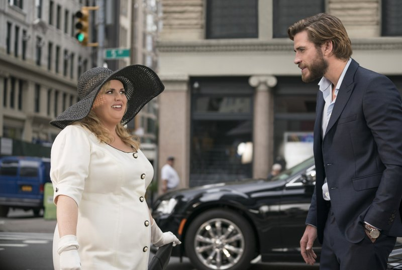 This image released by Warner Bros. Pictures shows Rebel Wilson, left, and Liam Hemsworth in a scene from the film,