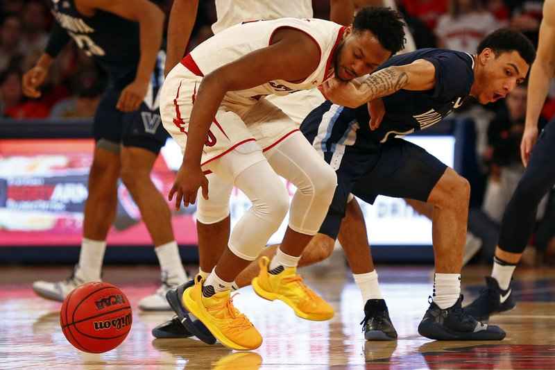 St. John's guard Shamorie Ponds and Villanova guard Jahvon Quinerly (1) battle for the ball during the first half of an NCAA college basketball game Sunday, Feb. (AP Photo/Adam Hunger)